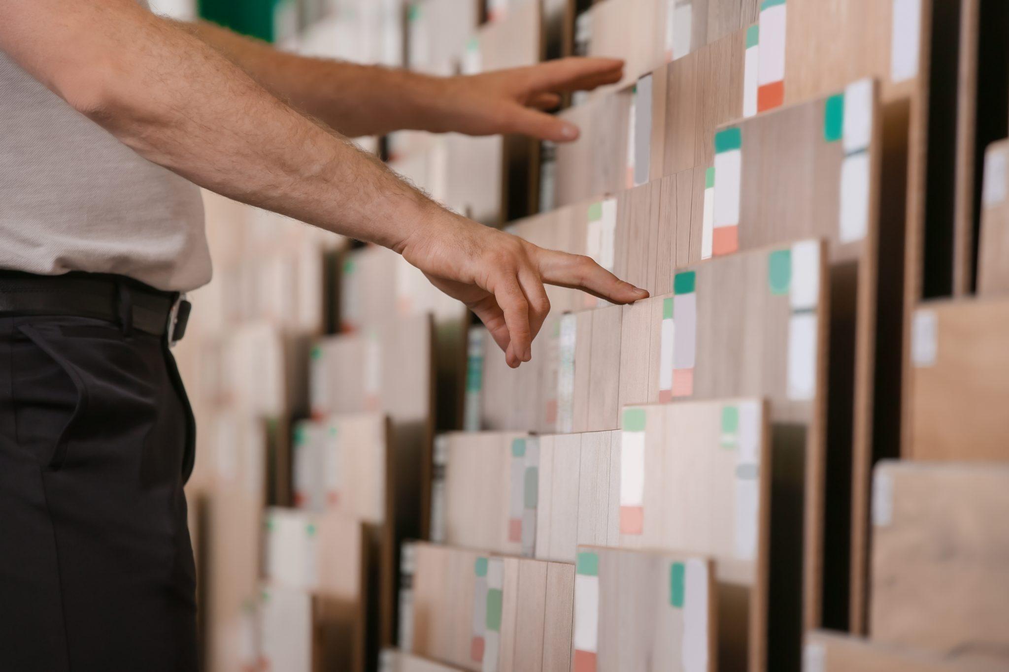 Man choosing laminate samples in hardware store