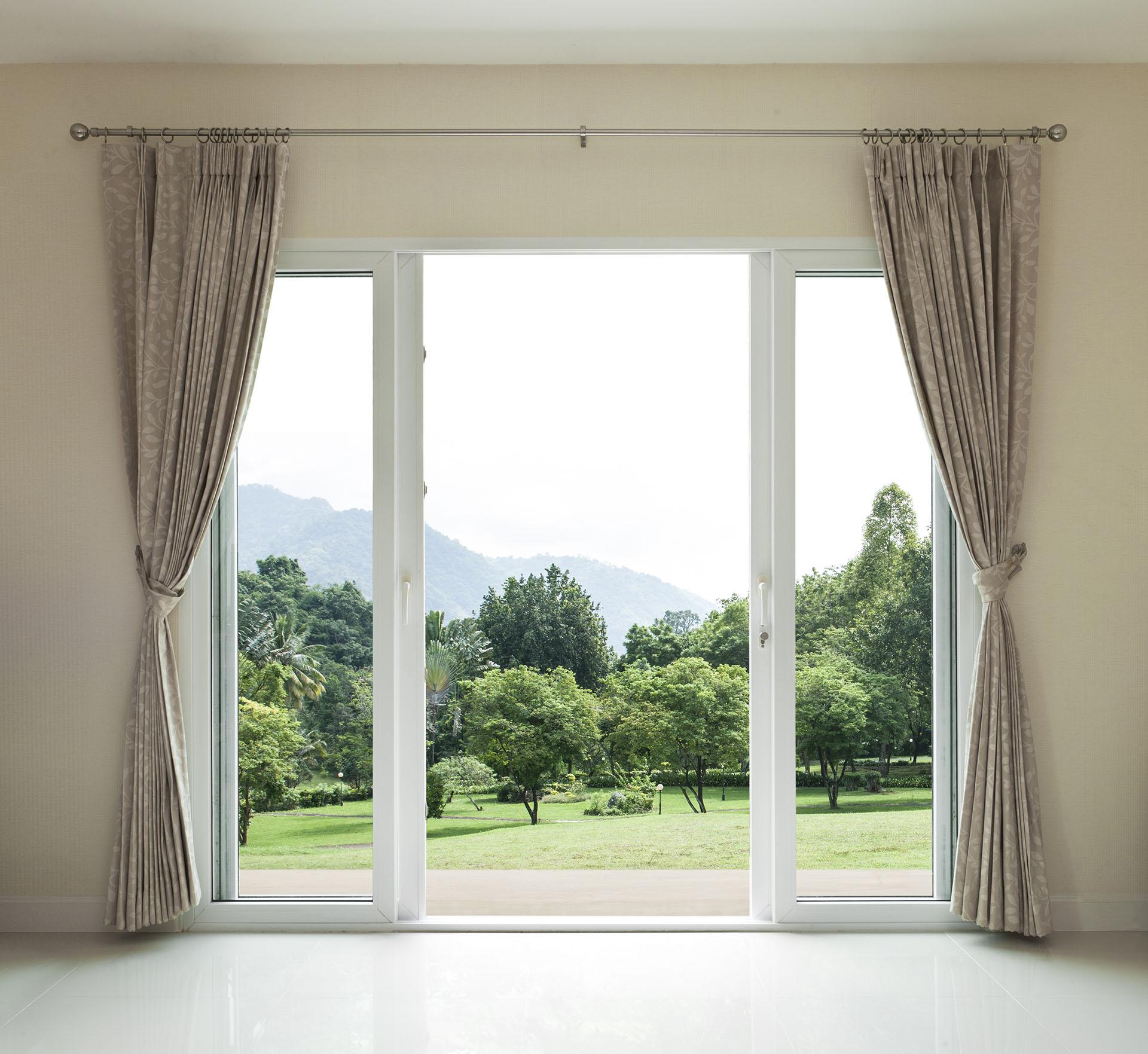 Opened door,  green garden view